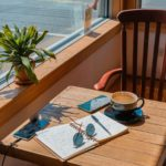 notebook coffee pencil sunglasses in cafe for writers connect newsletter issue 42