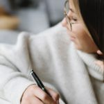 woman writing for post trends in writing for 2021