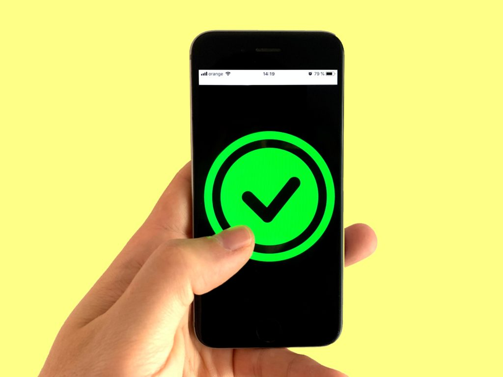tick mark on mobile phone for what is grammarly and how can it help me
